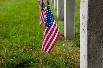 America's most recent war dead lie in a quiet patch of ground at Arlington National Cemetery known as Section 60. More than 350,000 American Flags decorate the graves at Arlington National Cemetery in preparation for Memorial Day weekend.  Friday May 28, 2010 (Photo by Jeff Malet)