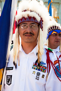 Flag bearer Earl Heavyrunner is a member of the Blackfeet Warrior Society Veterans of Browning Montana, here awaiting Presentation of Colors at Arlington National Cemetery on the day of the 142nd Memorial Day observance at the cemetery on  May 31, 2010 (Photo by Jeff Malet)