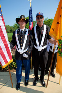 Flag bearers Sgt. Christopher G. Debord and Jim Tyson wait for the Presentation of Colors at Arlington National Cemetery on the day of the 142nd Memorial Day observance at the cemetery on  May 31, 2010 (Photo by Jeff Malet)