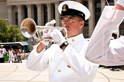 Taps is sounded at Naval District Washington's Wreathlaying ceremony accompanied by the U.S. Navy Band, with speaker RDML Patty Wolfe, SC, USN, Commander of Naval Expeditionary Logistics Support Group (NAVELSG) at the United States Navy Memorial in Washington DC on Memorial Day May 31, 2010. (Photo by Jeff Malet)