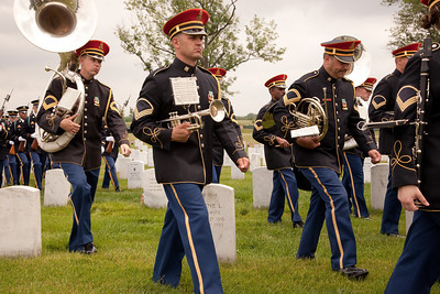 """Soldiers from the U.S. Army's 3rd Infantry Regiment, """"the Old Guard"""" participate in funeral services at Arlington National Cemetery. More than 350,000 American Flags decorate the graves at Arlington National Cemetery in preparation for Memorial Day weekend.  Friday May 28, 2010 (Photo by Jeff Malet)"""