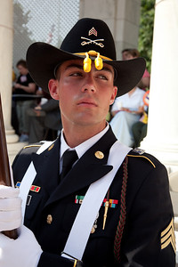 Flag bearer Sgt. Christopher G. Debord waits for the Presentation of Colors at Arlington National Cemetery on the day of the 142nd Memorial Day observance at the cemetery on  May 31, 2010 (Photo by Jeff Malet)