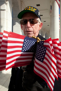 Brian Bixler of Lorel MD, a volunteer for the event, hands out free flags