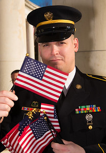 Army E5 Brandon Klein HHC 4-3 hands out free flags to all visitors