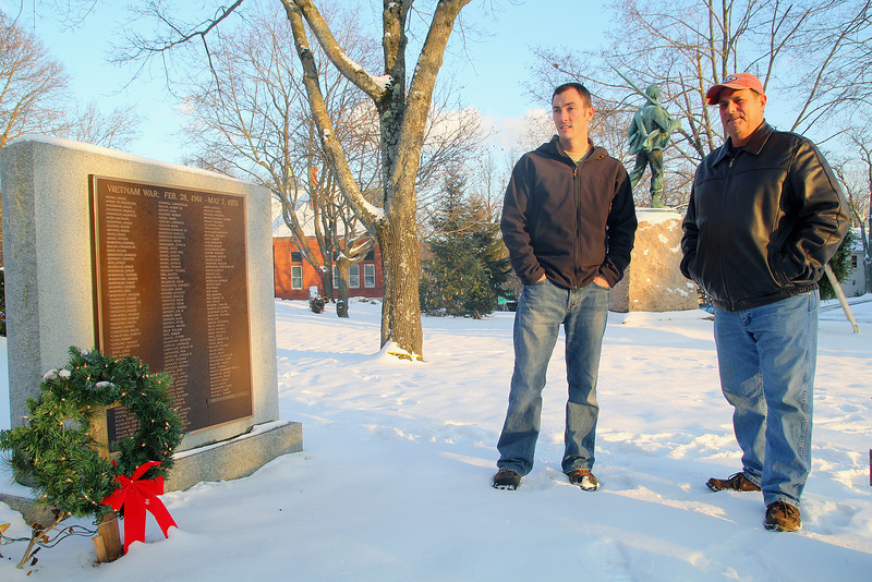 Air Force veteran Senior Airman Nick Davis and Army veteran specialist 4 class Rick Boucher look over some of the veteran memorial that sit out in front of the town hall in Ashburnham. SENTINEL & ENTERPRISE/ JOHN LOVE