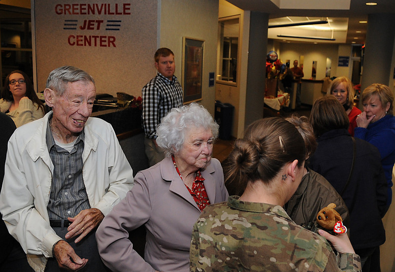 Asheton Frady is welcomed home by family and friends at the Greenville Downtown Airport.<br /> GWINN DAVIS PHOTOS<br /> gwinndavisphotos.com (website)<br /> (864) 915-0411 (cell)<br /> gwinndavis@gmail.com  (e-mail) <br /> Gwinn Davis (FaceBook)