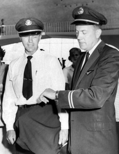 H.M. Ladet and Charles Bossert Waiting For the Time to Put their Picket Signs at The Airport. 1962