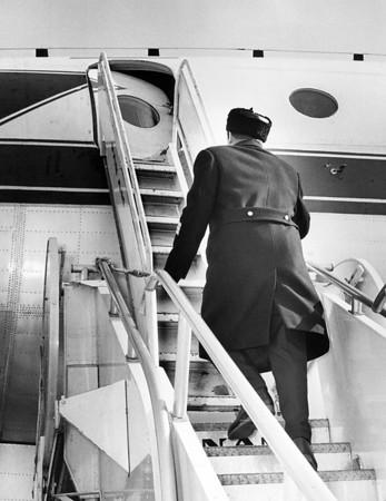 Waskli Tonushkin, Going Up Steps of Russian Plane.  1965