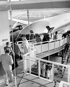 Airports  Kennedy; People Loading  Onto Airplane. 1961