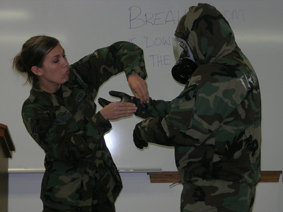 SRA Billings helps Jason get his gloves on.