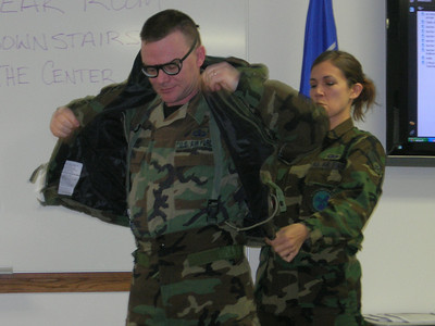 MSGT Jason Kamp was delighted to demonstrate how the chem suit fits.