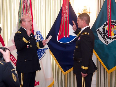 MG Wharton administers the oath to newly promoted BG Daniel G. Mitchell