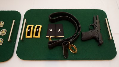 U.S. Army symbols of authority of a brigadier general- shoulder boards, epaulet insignia, belt, and personal side arm