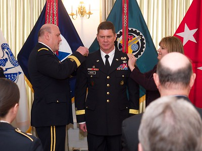 Laurie & MG Wharton attach the shoulder board insignia of a brigadier general