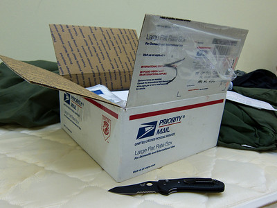 You've got mail. I love that line. Not because of the cheesy chick flick, no offense ladies, but because getting mail while overseas is one of the best experiences for a deployed Soldier. Whether you get told in passing from another Soldier coming from the mail room or by email or phone you are instantly transported back to a simpler time. Imagine yourself as a small child staring at the presents under the Christmas tree or on the table at your birthday. It's basically like that. You can't wait to rip it open and discover what's inside. You know that somebody was thinking about you and  cared enough to take time out of their busy life to do send you a little love in a box. It also helps that's there usually great stuff in the box you can't find in your immediate area. Home made brownies or even your favorite deodorant. The same rings true for even the simplest of letters. The digital realm of emails, video chats and Skype are nice but they can't compare to the physical letter. Especially if that letter smells like your loved ones. Oh and I wouldn't be a very good commentator if I didn't say something about the knife. It's a unwritten rule that all Soldiers must have a giant knife. Not for the intended purpose of stabbing something with it. But for the simple tasks of cleaning your nails, opening mail or opening a MRE. If a simple pocket knife will do then a huge knife is infinitely better. Really though one of the best uses I saw for these was to provide my medics with good training after somebody stupidly sliced their finger almost completely off. Saw it happen on multiple occasions.