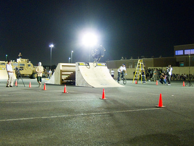 If I'm not mistaken, this guy did a backflip on this attempt. Notice the nice big MRAP in the background. The riders were have a blast performing tricks off of that beast.