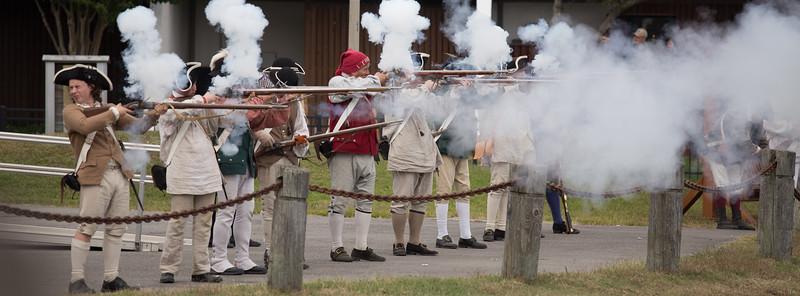 Taking the battle ashore, colonial militiamen fight back against loyalists.