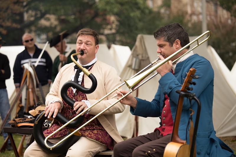 Camp musicians entertain the militia.