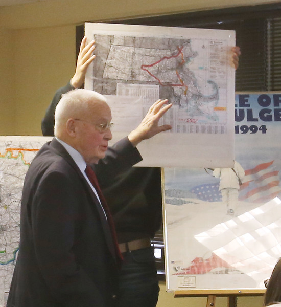 Talk on Battle of the Bulge in WWII, in its 75th anniversary year, at the Fort Devens Museum. Chris de Marcken, 92, of Worcester, who was an American teenager living in Belgium during WWII, because his father had been working in Europe, shows the area of the Battle of the Bulge superimposed on a map of Massachusetts. (SUN/Julia Malakie)