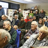 Overflow crowd listens to talk on Battle of the Bulge in WWII, in its 75th anniversary year, at the Fort Devens Museum. (SUN/Julia Malakie)