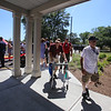 Ribbon cutting and opening ceremony for Bedford Green, housing for homeless and at-risk veterans, on the campus of the Edith Nourse Rogers Memorial Veterans Hospital in Bedford. Residents Arland Reynolds, right, a Navy Vietnam veteran, and Michael Kaminsky, center, a WWII veteran who was in the 42nd Infantry, come back in after the ceremony. (SUN/Julia Malakie)