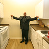 Bedford Green, housing for homeless and at-risk veterans, on the campus of the Edith Nourse Rogers Memorial Veterans Hospital in Bedford. Resident Michael Sexton shows off his kitchen. (SUN/Julia Malakie)
