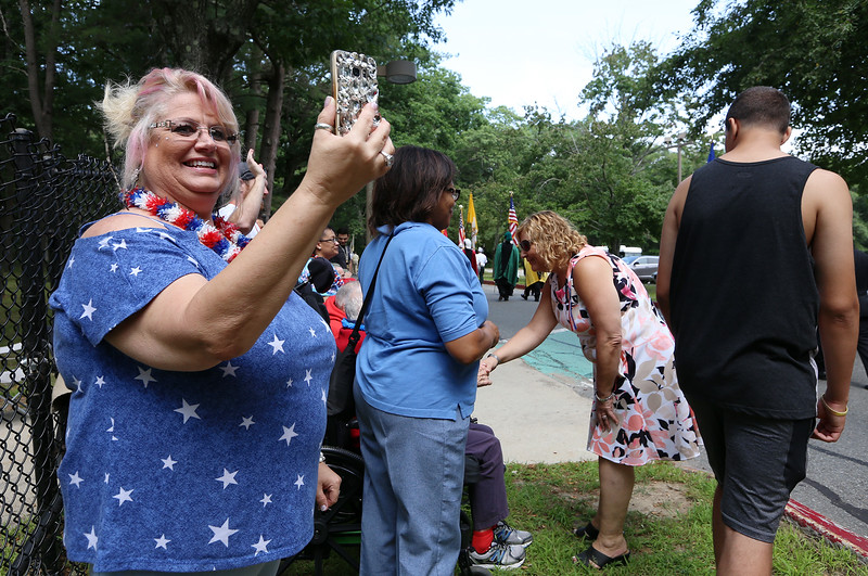 Celebration of 90th anniversary of the Bedford VA begins with a one-mile Salute Parade/Walk around the campus. Valerie Bergeron of Billerica, a recreational therapy assistant, watches the parade. (SUN/Julia Malakie)