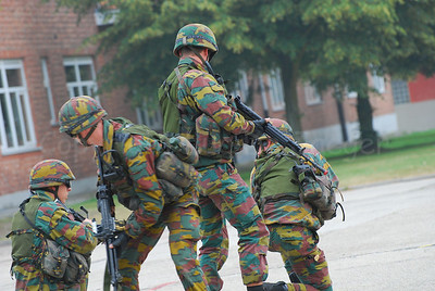 Infantry soldiers of the Belgian Army in training. They all wear goggles by Revision Eyewear and handle FN (assault) rifles.