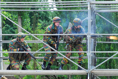 Soldiers of the Belgian Army during a MOUT Training (Military Operations in Urban Terrain). A soldier shoots.