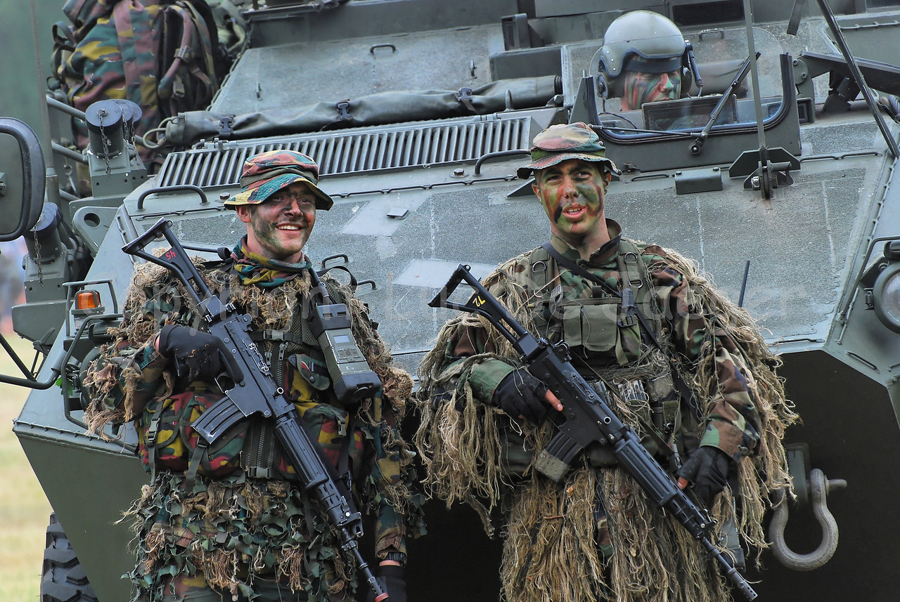 Two snipers of a Paratrooper Batallion of the Belgian Army in front of a Pandur Recce vehicle.