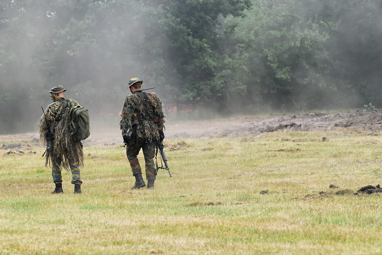 Snipers of a Paratroopers Batallion of the Belgian Army in the fields taking their positions.