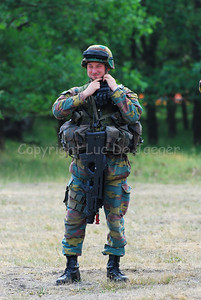 A Belgian Infantry soldier in full gear and carrying the FN F2000 rifle.