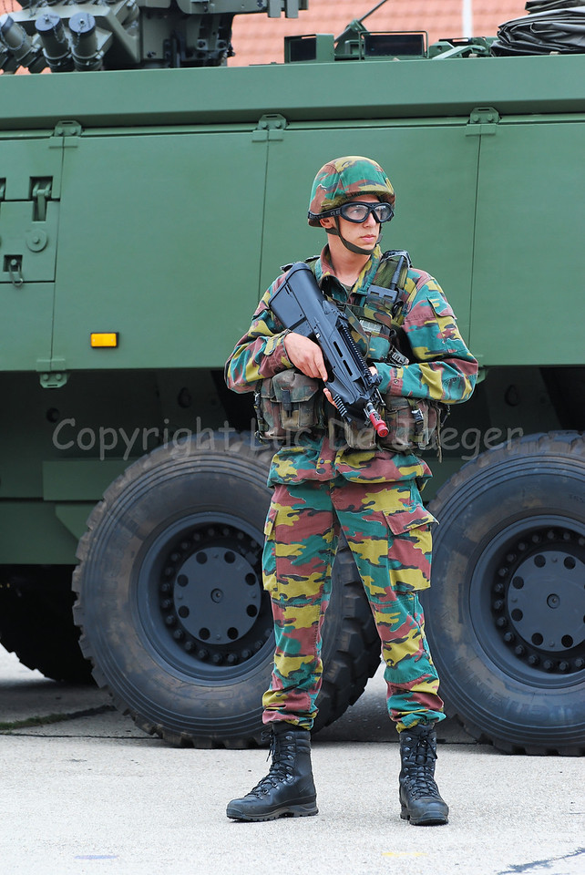 This Belgian infantry soldier in front of the brand new AIV (Armored Infantry Vehicle) Piranha IIIC, handles the FN F2000 assault rifle and wears goggles by Revision Eyewear.