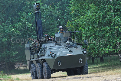 The Pandur Recce Vehicle in action in the fields.