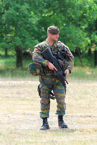 A Belgian Infantry soldier in full combat gear and handling the FN F2000 rifle.