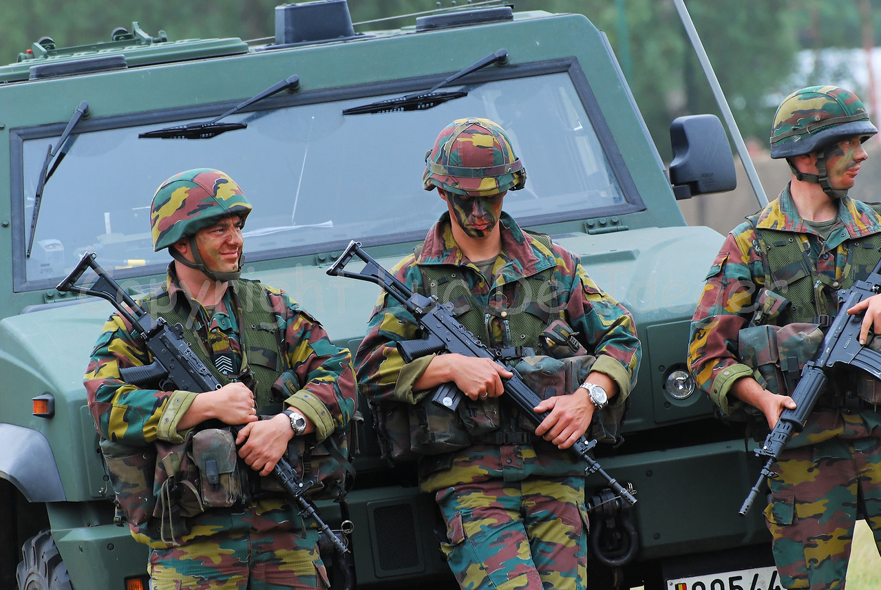 An infantry section of the Belgian Army on front of the Iveco LMV (Light Multirole Vehicle) that replaces the VW Iltis Jeeps. The soldiers carry the FN FNC rifle.