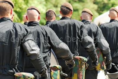 Belgian infantry soldiers in riot gear.