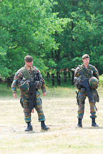 Belgian Infantry soldiers equipped for the fight. The left soldier carries the FN F2000, the right one carries the FN FNC.