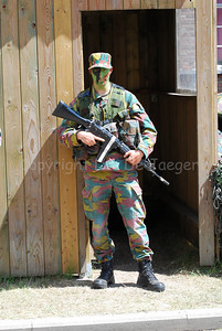 A Belgian infantry soldier on guard at a checkpoint. He's armed with the FN FNC rifle.