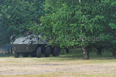 A Pandur Recce Vehicle in use by the Belgian Army proceeding in the fields.