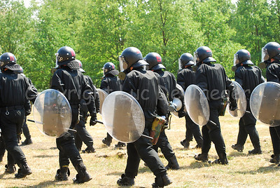 Belgian infantry soldiers in full riot gear.