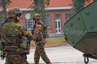 Infantry soldiers of the Belgian Army in training. They all wear goggles by Revision Eyewear and handle FN (assault) rifles. The soldiers accompany the brand new AIV (Armoured Infantry Vehicle) Piranha IIIC manufactured by MOWAG that will replace the Leopard 1A5 MBT in the Belgian Army.