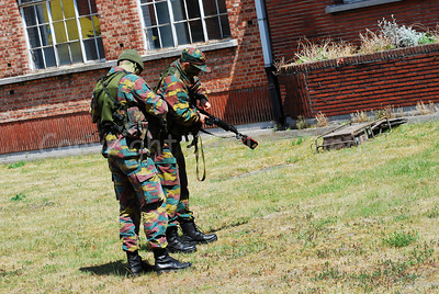 Belgian infantry soldiers handling the FN FNC rifle.
