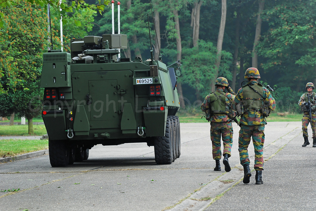 Infantry soldiers of the Belgian Army accompany the brand new AIV (Armoured Infantry Vehicle) Piranha IIIC manufactured by MOWAG that will replace the Leopard 1A5 MBT in the Belgian Army.