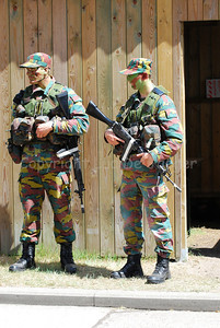 Belgian infantry soldiers on guard at a checkpoint. They are armed with the FN FNC rifles.