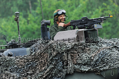 The gunner of the Leopard 1A5 tank. The Belgian Army decided to replace all tracked vehicles by faster and multipurpose wheeled vehicles. Between 2009 - 2015 the Leopard tank will be replaced by the Piranha IIIC.