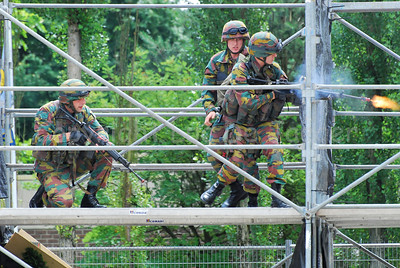 Soldiers of the Belgian Army during a MOUT Training (Military Operations in Urban Terrain). The soldiers shoot before proceeding.