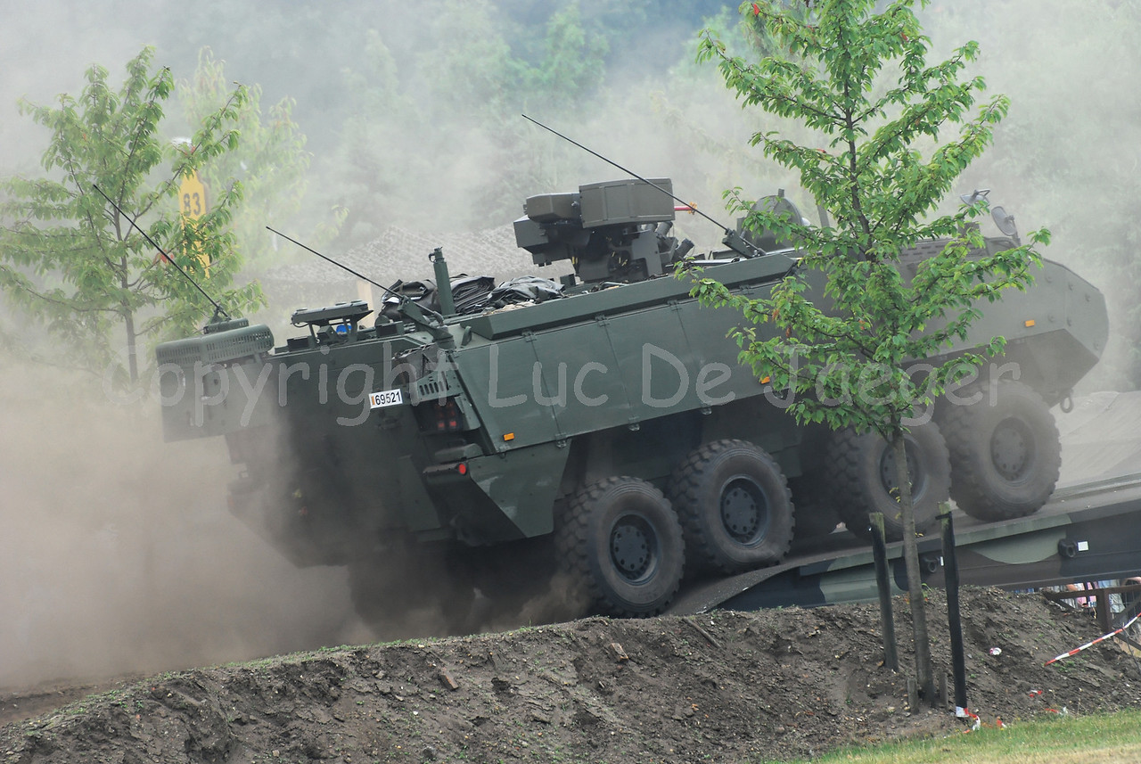 Crossing a bridge in the dust: the brand new AIV (Armoured Infantry Vehicle) Piranha IIIC manufactured by MOWAG that will replace the Leopard 1A5 MBT in the Belgian Army.