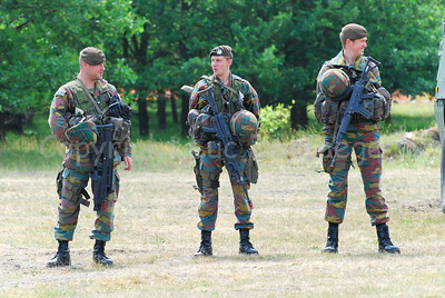 Belgian Infantry soldiers equipped for the fight. The left soldier carries the FN F2000, the others the FN FNC.