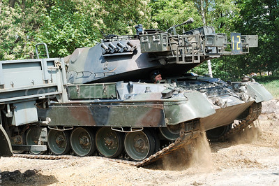 A Belgian Leopard 1A5 MBT driving backwards.